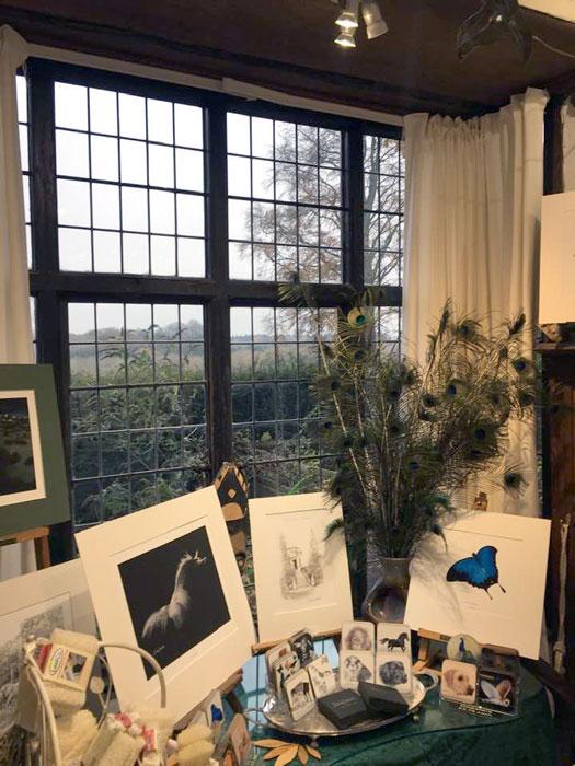 Larmer Tree Studio window displaying prints and coasters